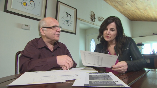 Sheldon Snider shows Go Public reporter Erica Johnson his lengthy and complicated Rogers bill. (Christer Waara/CBC)
